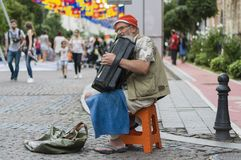 Old musician on the street Stock Photos