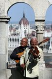 Old musicians on the background of an old building Royalty Free Stock Images