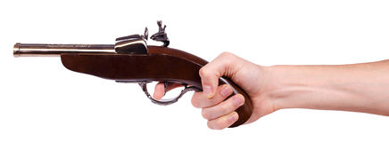Old musket gun in male hand Stock Photo