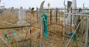Old Muslim graves in the field of dry grass with stock footage