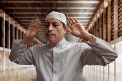 Old muslim man praying. In mosque Royalty Free Stock Photography