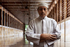 Old muslim man praying. In mosque Stock Photography