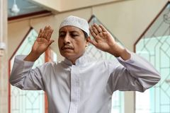 Old muslim man praying inside mosque Stock Images