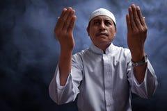 Old muslim man praying. With smoke background Royalty Free Stock Photo