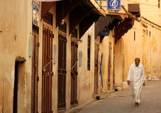 Old muslim man walking in the medina Royalty Free Stock Image