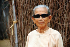 Old Myanmar woman wearing shades Royalty Free Stock Images
