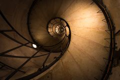 Old staircase in Paris France. Old mysterious staircase in Paris France stairs below dark triumphal gate abstract round ladder historic triomphe up europe stock photography