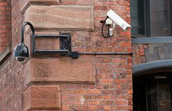 Old n New. Old and new style cctv cameras on a restored warehouse Stock Image