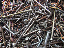 Old nail and screw. Couple of old nail and screw of the different size or kind Royalty Free Stock Photo