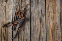Old nails and clipper on rustic wooden table Royalty Free Stock Images