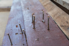 Old nails in the wood. En surface royalty free stock photo