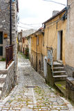 Old narrow cobbled street in a town Royalty Free Stock Photography