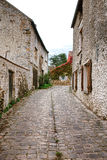 Old Narrow Cobblestone Street in French Village Royalty Free Stock Image