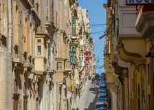 Old narrow street of european town (Valletta, Malta) Royalty Free Stock Images