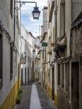 Old Narrow Street in Evora in Portugal Stock Image