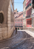Old narrow street in Lisbon Royalty Free Stock Images