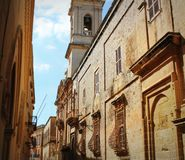 Old Narrow Street of Mdina with Carmelite Church Bell Tower - Mdina, Malta.  Stock Photography