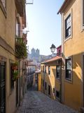 Old narrow street in Portuguese town Oporto Royalty Free Stock Photography