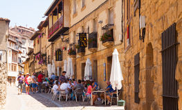 Old narrow street with restorain in Frias. Burgos Royalty Free Stock Photo