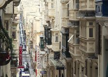 Old Narrow Street With Traditional Closed Wooden Balconies In Valletta. December 19, 2018 - Valletta, Malta Royalty Free Stock Image