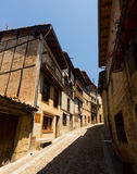 Old narrow street with typical houses in Frias. Burgos Royalty Free Stock Images