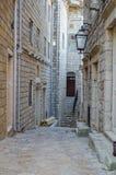 Old narrow street in Ulcinj. Old narrow street in Stari Grad of Ulcinj, Montenegro. The fortress in the Old town in a sunny summer day Stock Image