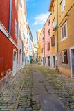Old and narrow streets in Piran city, Slovenia. Ancient medieval streets in town center of famous European city, near the adriatic. Sea. Old houses with wooden royalty free stock photos