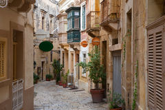 Old narrow town street. Of Vittoriosa. Malta Stock Images