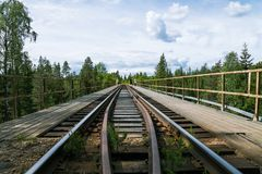 Old and narrow wood and steel construction railroad bridge Stock Image