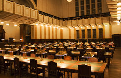 Old National library. National library - reading room, illuminated with plenty small desktop lights, making cosy ambient light Stock Photos