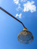 Old native handcraft street lamp made from bamboo. Bottom-up view of old street lamp made from bamboo designed as chicken coop. It is hung on brown pillar made Royalty Free Stock Photography