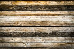 Old natural brown barn wood wall. Wooden textured background pattern. Old weathered brown barn wood wall. Wooden wall background design. Wood planks, boards are royalty free stock photos