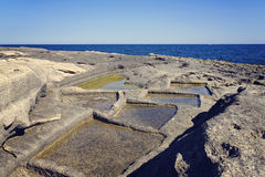The old natural method of salt extraction in Malta. Stock Image