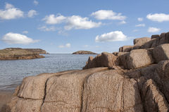 Old natural rock formation on a rocky beach Stock Photography