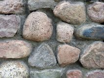 Old natural stones wall, Lithuania stock image