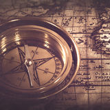 Old nautical compass over the map Stock Image