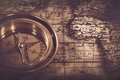 Old nautical compass over the map Stock Photos