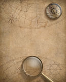 Old nautical map with compass and loupe Royalty Free Stock Photo