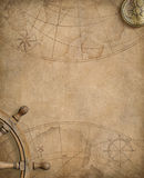 Old nautical map with compass and steering wheel Royalty Free Stock Images