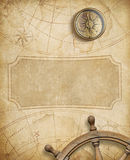 Old nautical map with compass and steering wheel Stock Photography
