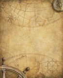 Old nautical map with compass and steering wheel Stock Images