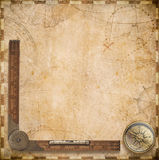 Old nautical map with compass and wood ruler Royalty Free Stock Images
