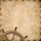 Old nautical map with steering wheel Stock Photo