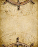 Old nautical map with two steering wheels Royalty Free Stock Photography