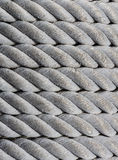 Old nautical rope, texture and background. Old nautical rope, close-up as nautical background and horizontal texture Stock Photos