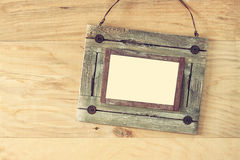 Old nautical wooden frame on wooden table. Old nautical wooden frame on wooden table Stock Image