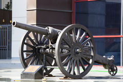 Old naval cannon in the park Royalty Free Stock Image