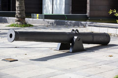 Old naval cannon in the park Stock Image