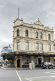 The old Naval Family Hotel now a strip club, Auckland. Auckland, New Zealand - March 1, 2017:  Cream white facade of the historic Naval Family Hotel, now Stock Photos