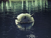 An old naval mine. In the pond Stock Photo